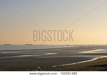 Sunrise over the beach at Arromanches, France