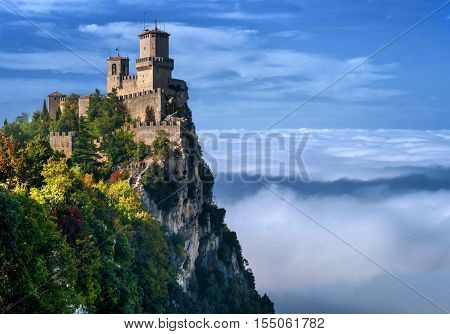Rocca della Guaita, the most ancient fortress of San Marino, Italy. The fog at the bottom creates the illusion of clouds.