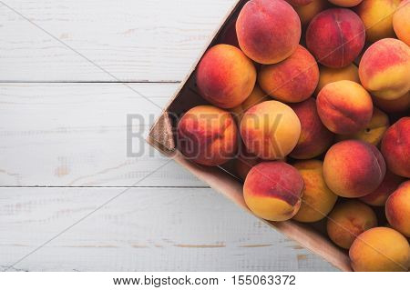 Peach Fruits On Wood Basket
