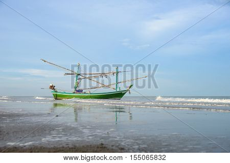 Long tail fisherman boat anchor at the beach in Thailand