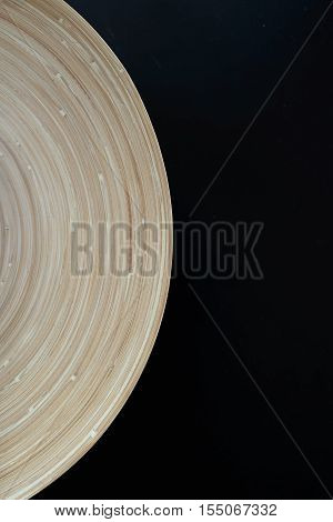 Wooden plate curvature on black background with Copy Space