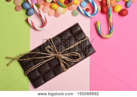 Colorful Dragee With Chocolate Bar