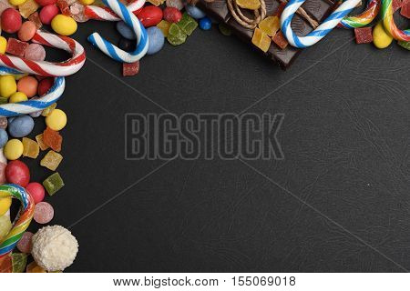 Black Textured Background With Colorful Dragee