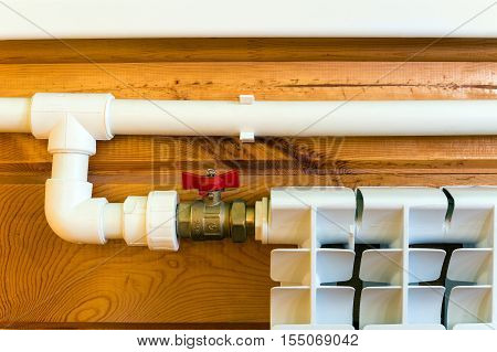 Heating radiator and polypropylene pipes in a wooden house