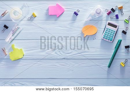 Office business education still life concept on blue wooden background. Top view of wooden desktop with bright colorful stationery items. Set of stationery flat lay.