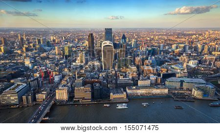 London England - Aerial skyline view of the city of London at sunset. This view includes River Thames the financial Bank district London bridge famous skyscrapers and the Monument