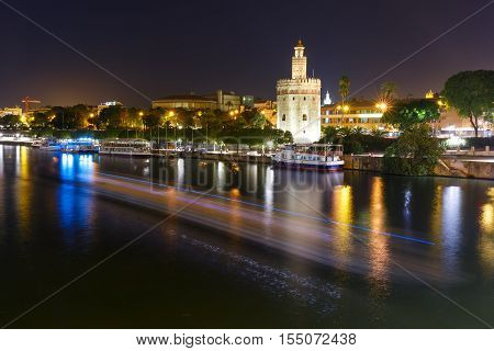 Dodecagonal military watchtower Golden Tower or Torre del Oro at night, Seville, Andalusia, Spain
