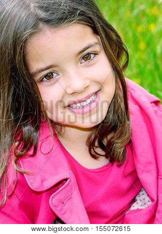 Cute Child With Flower Garden On Background