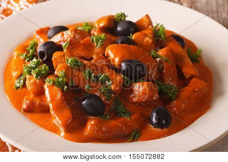 Spanish Food: Pork Raxo In Spicy Sauce With Olives Close-up. Horizontal