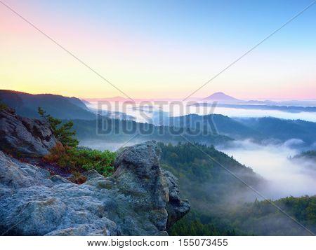 Misty Awaking Of  Beautiful Fairy Valley. Peaks Of Rocks Above  Creamy Fog
