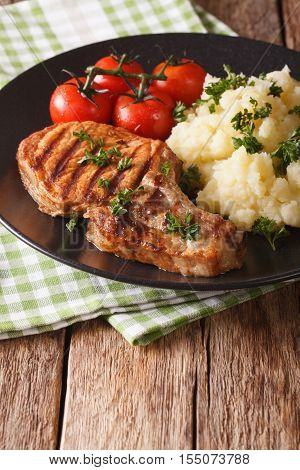 Grilled Pork Loin With Mashed Potatoes And Tomato Close-up. Vertical, Rustic