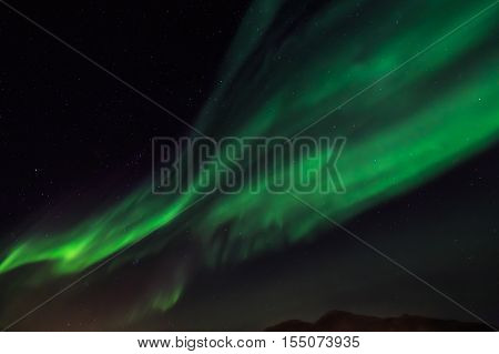 Green Northern Lights And A Stirlight Sky  Over Nuuk City, Greenland