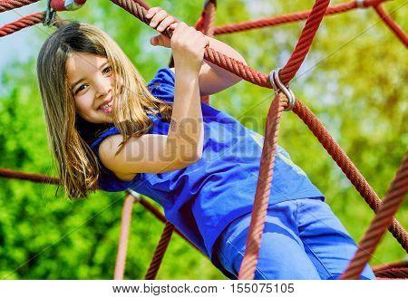 Kid Girl Doing Rock Climbing