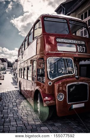 Retro style sightseeing double-decker bus. HILDESHEIM GERMANY - JULY 30, 2016,  parade of vintage cars.