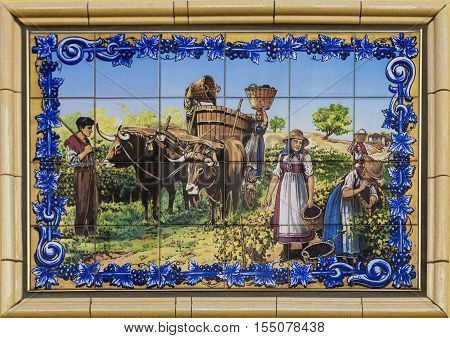 CRUZY, FRANCE - JULY 22, 2015: Artistic tiles depicting village scene. Cruzy is a wine village in Languedoc-Roussillon region. with hundreds of vineyards domaines chateaux and small producers making wines.