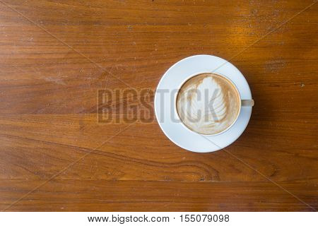 Top View Of A Cup Of Hot Coffee Put On Old Wooden Table Background