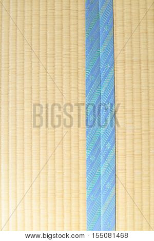 Tatami with light blue edging ribbon, vertical