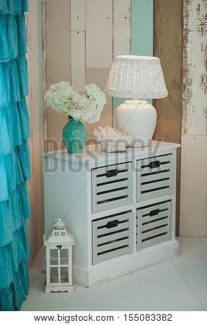 Photo of chest of drawers in wardrobe of extravagant house.