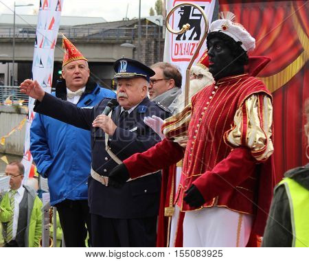 AALST, BELGIUM, NOVEMBER 5 2016: Actor Anton Cogen beter known as Commissaris Migrain from the popular Mega Mindy series, entertains the crowds during the arrival of St. Martin in Aalst.