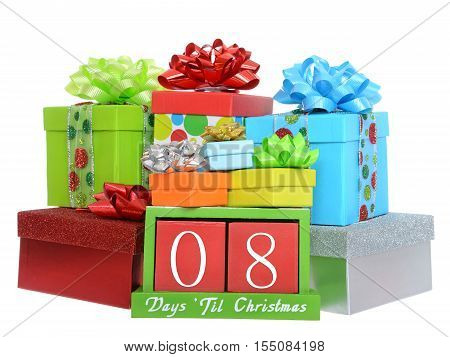 08 Days until Christmas red wood blocks in a green box with presents stacked on and around it isolated on a white background.