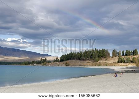 Tekapo, New Zealand - February 2016: People Relaxing By Lake Tekapo, South Island Of New Zealand, Wi