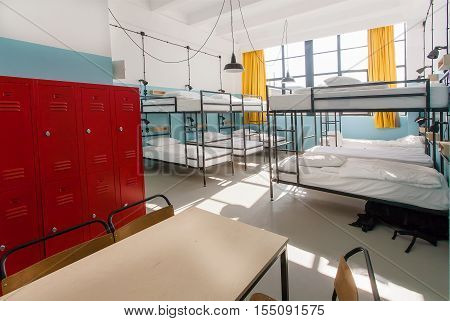 TBILISI, GEORGIA - OCT 9, 2016: Interior of the new backpackers hostel with modern bunk beds inside the empty dorm room on 9 October, 2016. The annual number of tourists in Georgia reached 2300000 people