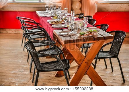 sumptuous Banquet in a wooden gazebo is beautifully decorated in a traditional style.
