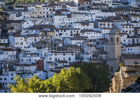 Alcala del Jucar Spain - October 29 2016: Panoramic view of typical houses of city during autumn to the right church of San Andres take in Alcala of the Jucar Albacete province Spain