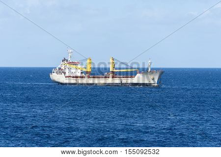 Dual crane ship for dredging in harbor bays and sea channels bottoms