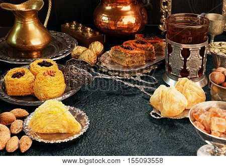 Large set of Eastern Arab Turkish sweets with copy space