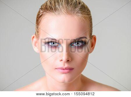 Studio beauty shot: closeup portrait of a beautiful young woman