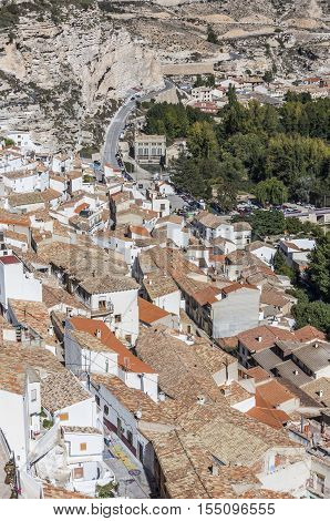 Alcala del Jucar Spain - October 29 2016: Houses and roofs next to mountain limestone view to the mountains of the river Jucar take in Alcala of the Jucar Albacete province Spain
