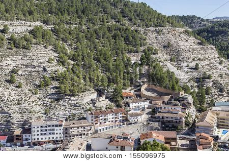 Panoramic view of modern part of the town and access to the castle to the right the old bullring in the shape of a ship view to the mountains of the river Jucar take in Alcala of the Jucar Albacete province Spain
