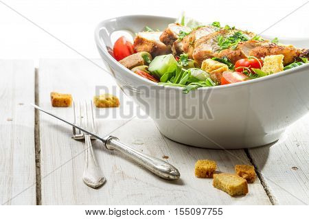 Close-up On A Fresh Salad With Chicken On White Background