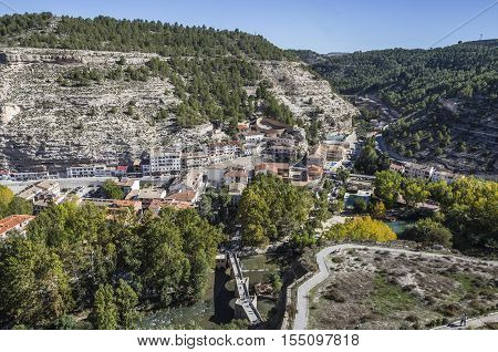 Alcala del Jucar Spain - October 29 2016: Panoramic view of modern part of the town and access to the castle to the right the old bullring in the shape of a ship view to the mountains of the river Jucar take in Alcala of the Jucar Albacete province Spain