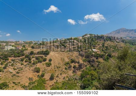 Agia Irini Rethymno Crete Greece. July 27. 2016: Panoramic view to mountains from Agia Irini Monastery. Crete attracts 2.8 million annual tourists (2011).