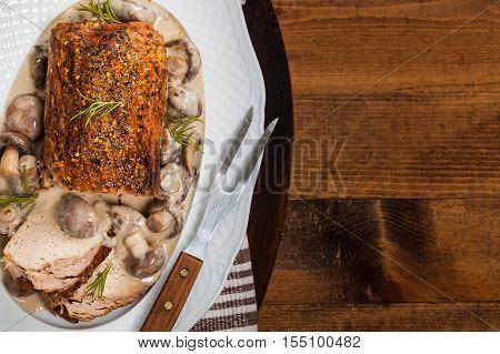 Roasted Pork Loin with Mushroom Gravy. Selective focus.