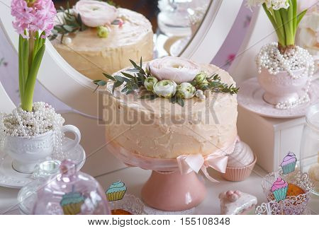 Dessert Table at Wedding Reception.Beautiful wedding cake with flowers on table