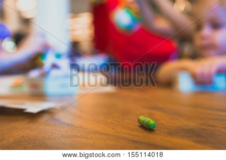 Green Color Pastel Crayon On Brown Wooden Table