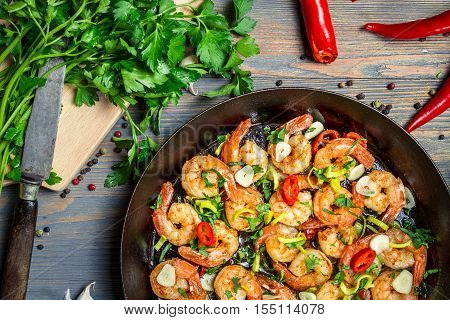 Shrimps Fried On Pan With Fresh Herbs