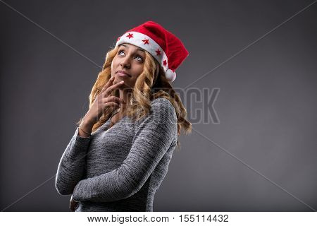Flirting Girl Thinking About A Gift For Christmas