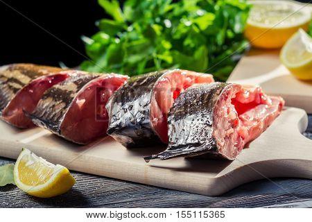 Fresh Fish With Lemon And Salt On Cutting Board