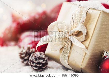Christmas presents or gifts with elegant bow and christmas decorations on bright snowy background christmas concept horizontal