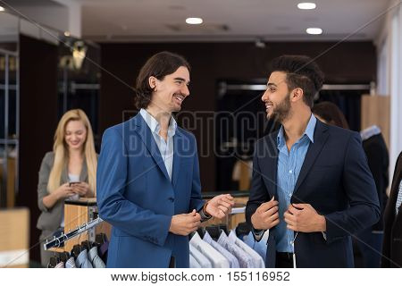 Handsome Business Man Fashion Shop, Customers Choosing Clothes In Retail Store Young People Shopping Formal Wear
