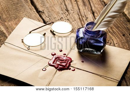 Inkwell With Feather On Envelope With Red Sealant And Glasses