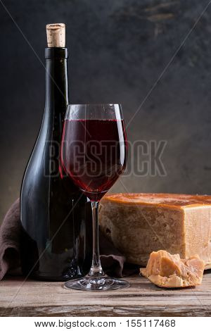 cheese and wine on a wooden board