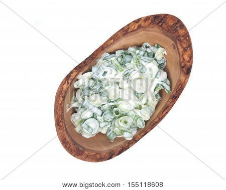 Organic green onion scallion salad with sour cream in bowl isolated on white background