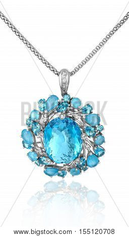Exquisite fashionable jewelry pendant made of white gold with big blue topaz. Gold pendant with topaz.