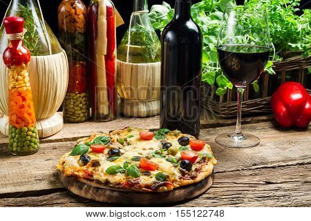 Baked Pizza Served With Wine On The Background Of Fresh Vegetables