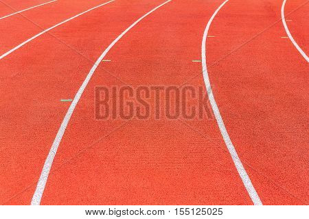 Running track texture or Running track background. Red running track at sport stadium. Athletic running track with copy space for text or image.